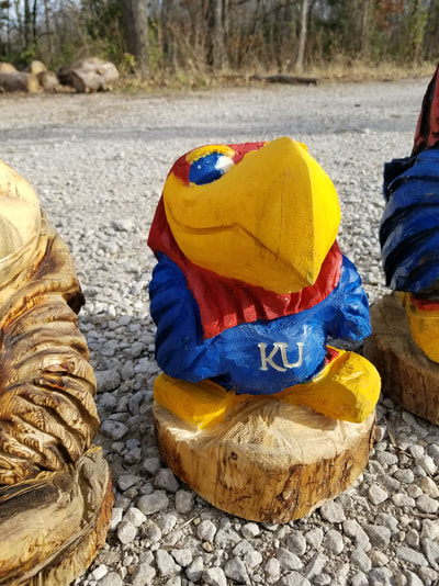 Chainsaw carved Jayhawk by Kansaw Carvings